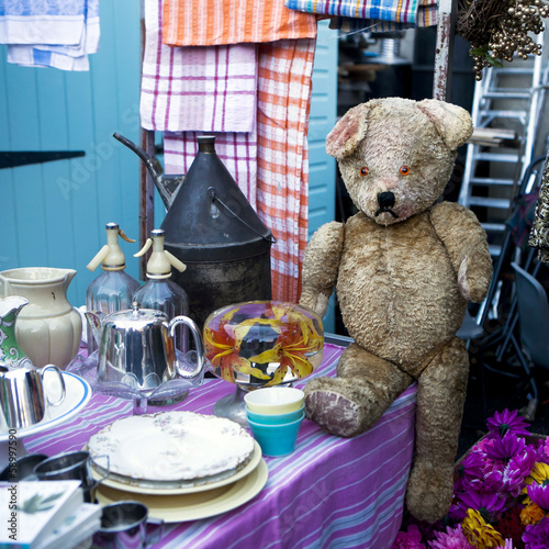 100 years old sad teddy bear on flea market