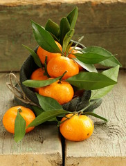 fresh ripe orange mandarins (tangerines) on a wooden table