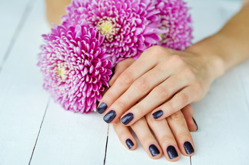 Spa manicure and delicate flowers