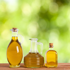 bottles of olive oil with natural background