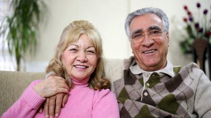 Senior couple sitting on sofa