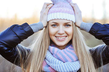 Fashionable young woman wearing hat and scarf
