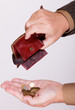 Broke businessman with empty wallet and polish coins