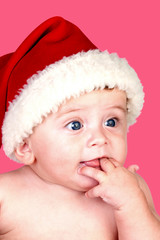Adorable baby with Christmas hat