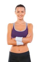 Sports woman portrait isolated on white background. Smiling fema