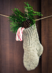Christmas sock on the wooden background.