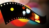 Film strip with clip of abstract dots of light in motion