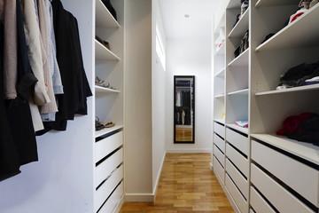 Contemporary walk in wardrobe