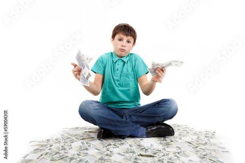 boy sitting on money