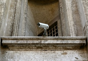 surveillance camera on old building