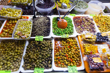 Various marinated olives in cans