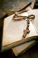 open book with rosary beads
