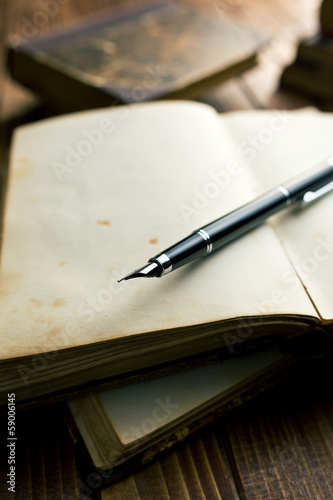 open book with fountain pen