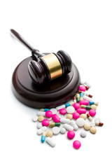 judge's gavel with pills