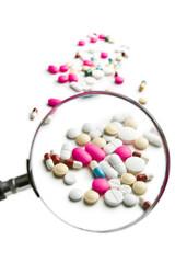 pills under magnifying glass
