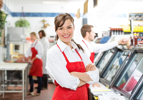 Confident Female Butcher Standing Arms Crossed - 59008576