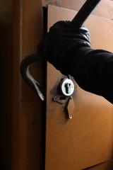 Burglar breaking the safe