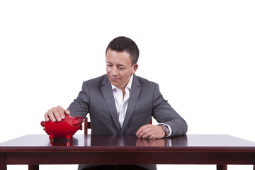 Businessman with his piggy bank at work