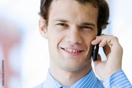 Businessman speaking mobile phone