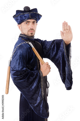 Martial arts master with nunchucks on white