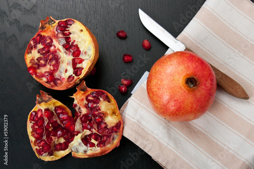 Pomegranate on dark wood