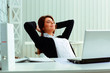 Young happy businesswoman resting in office