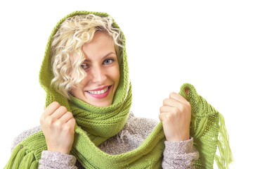Female wrapped with wool scarf and cap, isolated on white