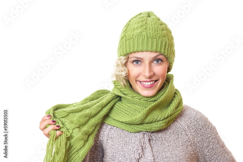 Happy girl with warmly - winter clothing, isolated on white