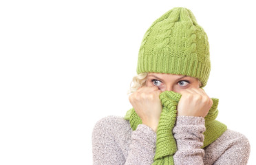 Young woman looking to side and wearing wool scarf and cap