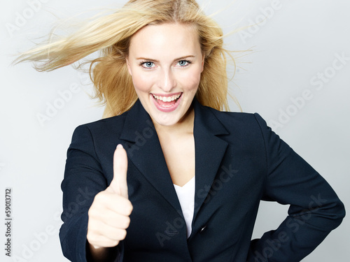 Successful business woman shows thumb up