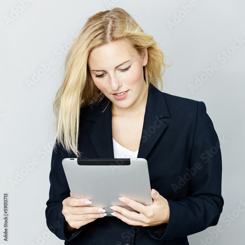 Business woman reading on touchpad