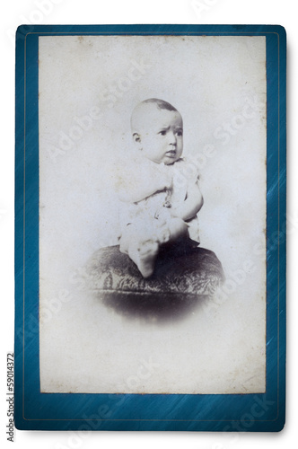 Antique Portrait of a little boy. Made ​​in a studio. Vintage Poster