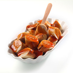 Spicy smoked sausage with ketchup