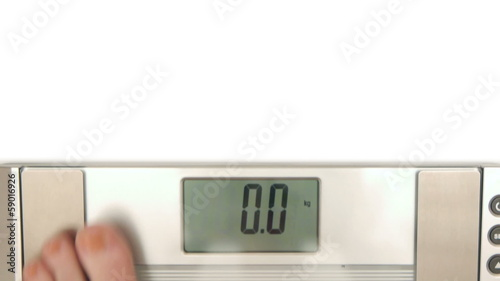 HD - Woman on weight scales