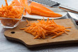 Grated carrots on board