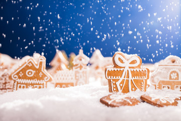 Christmas gingerbread with falling snow