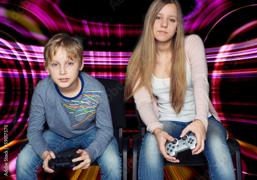 Boy and girl playing video games