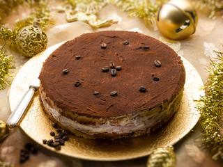tiramisu over golden christmas table, selective focus