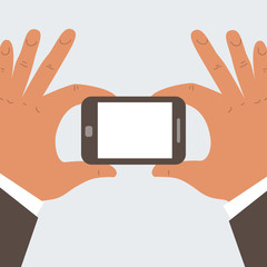 businessman hands holding mobile phone with blank screen
