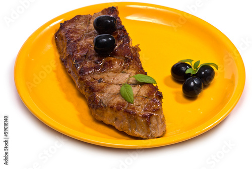 Beef Steak on Orange Plate isolated on white