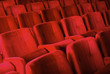 Red armchairs in theater