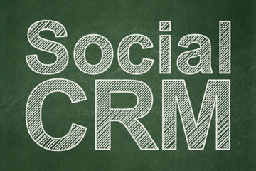 Business concept: Social CRM on chalkboard background