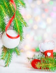 Christmas ball, red ribbon and sock