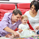 Happy family drawing and painting at home together