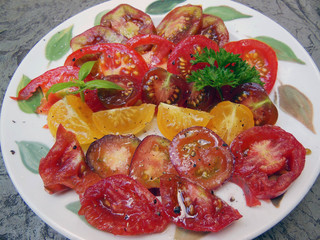 plate of sliced heirloom tomatoes