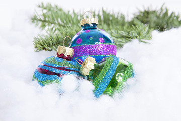 Colorful glitter Christmas balls over white background