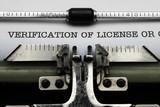Verification of license on typewriter poster