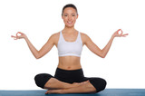 Smiling asian sitting in the lotus position