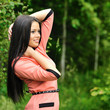 Portrait of young beautiful woman posing outdoors