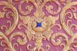 stucco wall burgundy color thai art